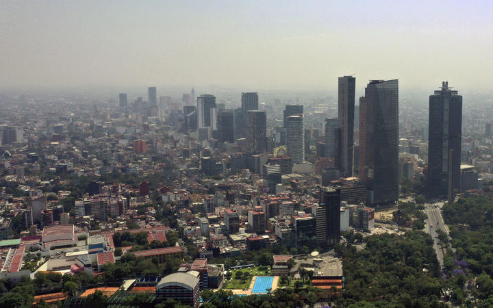 Aerial view showing low visibility due to air pollution in Mexico City, on April 1, 2020, during the coronavirus pandemic.