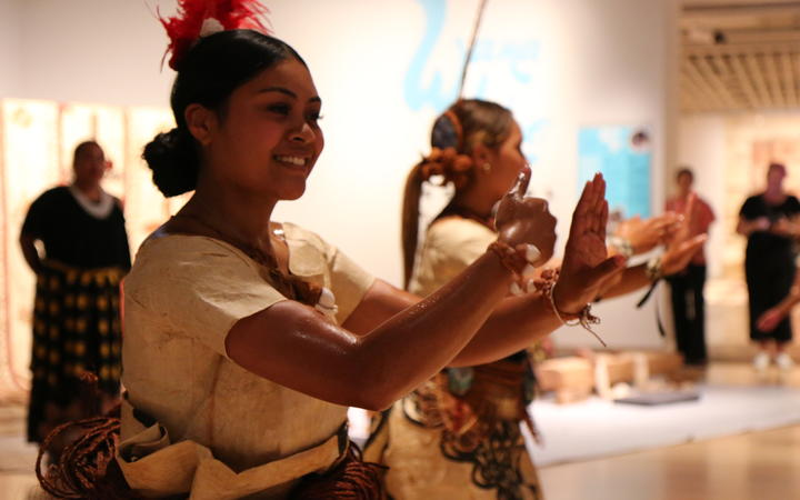 Daphnie Taulata (Left) performs a Tongan cultural dance at the Te Papa Museum in a costume made  of ngatu or bark cloth. Wellington February 2021