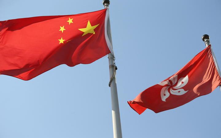 China national flag and Hong Kong flag wave in Hong Kong on Oct 10, 2020.