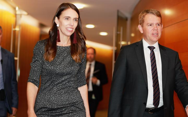 Jacinda Ardern and Chris Hipkins on their way to announce the trans-Tasman travel bubble start date.