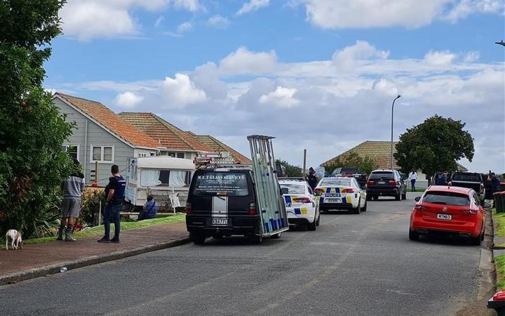 Police on Kitemoana Street in Orakei, Auckland.