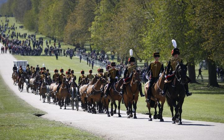 Members of the King's Troop Royal Horse Artillery ride up the Long Walk to Windsor Castle before Prince Philip's funeral service.