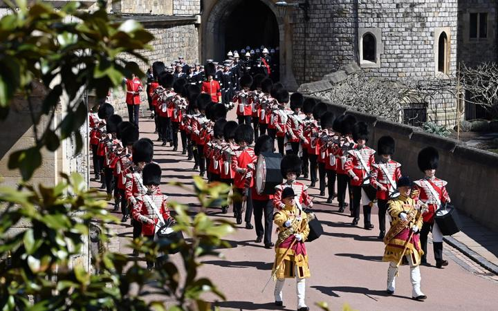 Members of a military band march into position at Windsor Castle in Windsor.