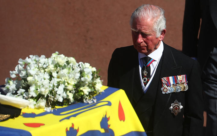 Prince Charles accompanies his father's coffin.