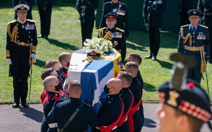Pallbearers of the Royal Marines carry the coffin into St George's Chapel for the funeral service of Britain's Prince Philip, Duke of Edinburgh in Windsor Castle in Windsor, west of London, on April 17, 2021.