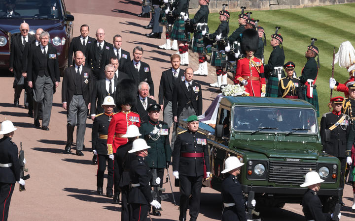 Members of the Royal family walk behind a land rover carrying the coffin of Britain's Prince Philip, Duke of Edinburgh during the ceremonial funeral procession to St George's Chapel in Windsor Castle in Windsor, west of London, on April 17, 2021.