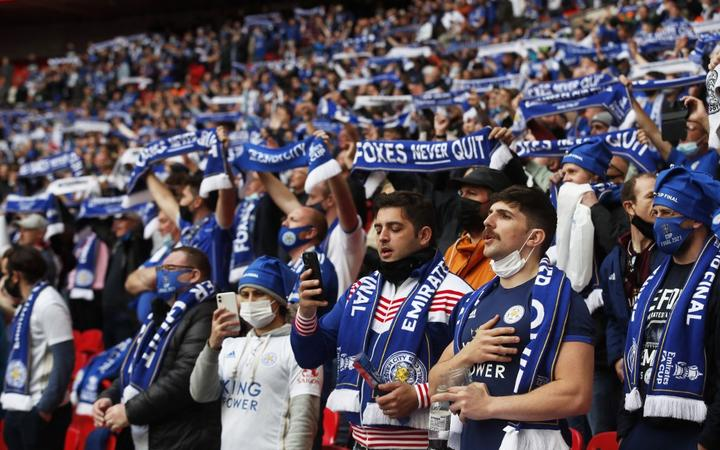 Leicester City fans cheer on their team ahead of the English FA Cup final football match between Chelsea and Leicester City at Wembley Stadium in north west London on May 15, 2021.