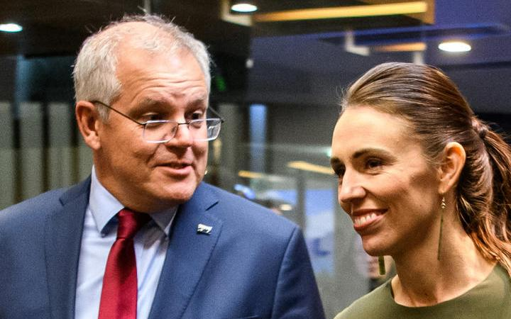 Australian Prime Minister Scott Morrison and New Zealand Prime Minister Jacinda Ardern arriving at a reception for the annual Australia-New Zealand Leaders' meeting in Queenstown on May 30, 2021.