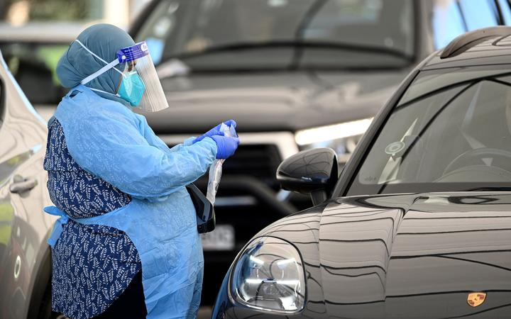 A health worker registers a resident at a Covid-19 drive-through testing site on Bondi Beach in Sydney on 17 June, 2021.