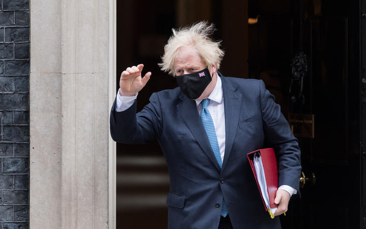 British Prime Minister Boris Johnson leaves 10 Downing Street for PMQs at the House of Commons.