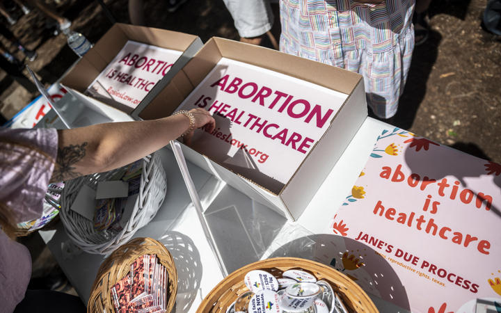 In this file photo attendees grab signs at a protest outside the Texas state capitol on May 29, 2021 in Austin, Texas.