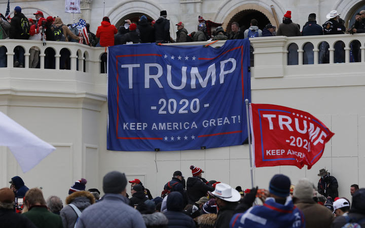 Supporters of US President Donald Trump storm the US Capitol during a rally to contest the certification of the 2020 US presidential election results by Congress at the Capitol Building in Washington.