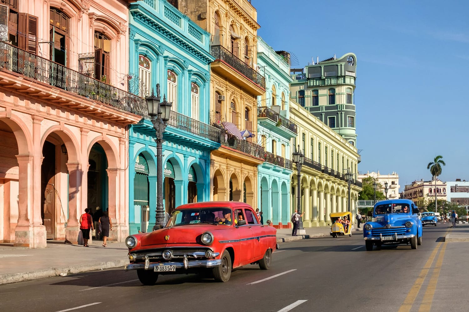 Street scene with colorful buildings and old american car in downtown Havana, Cuba