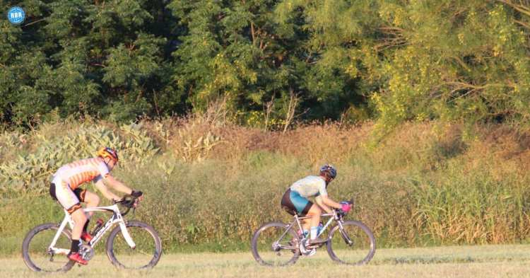 man and woman cycling different frames