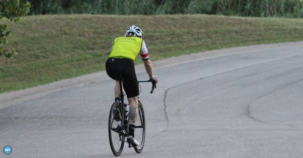 lone cyclist riding