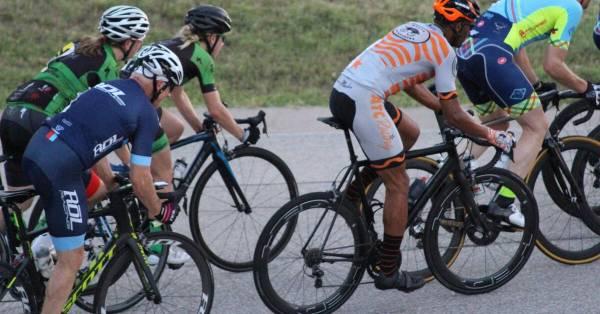 cyclists with aero wheels racing