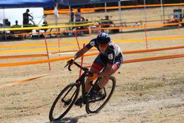 woman cyclocross racer cornering