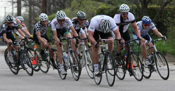 cyclists sprinting in a crit
