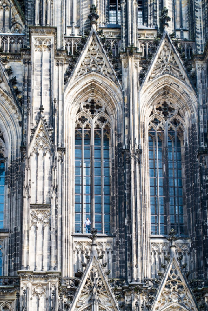 The Cologne Cathedral in Germany and its Gothic Facade - Spot the lucky guy