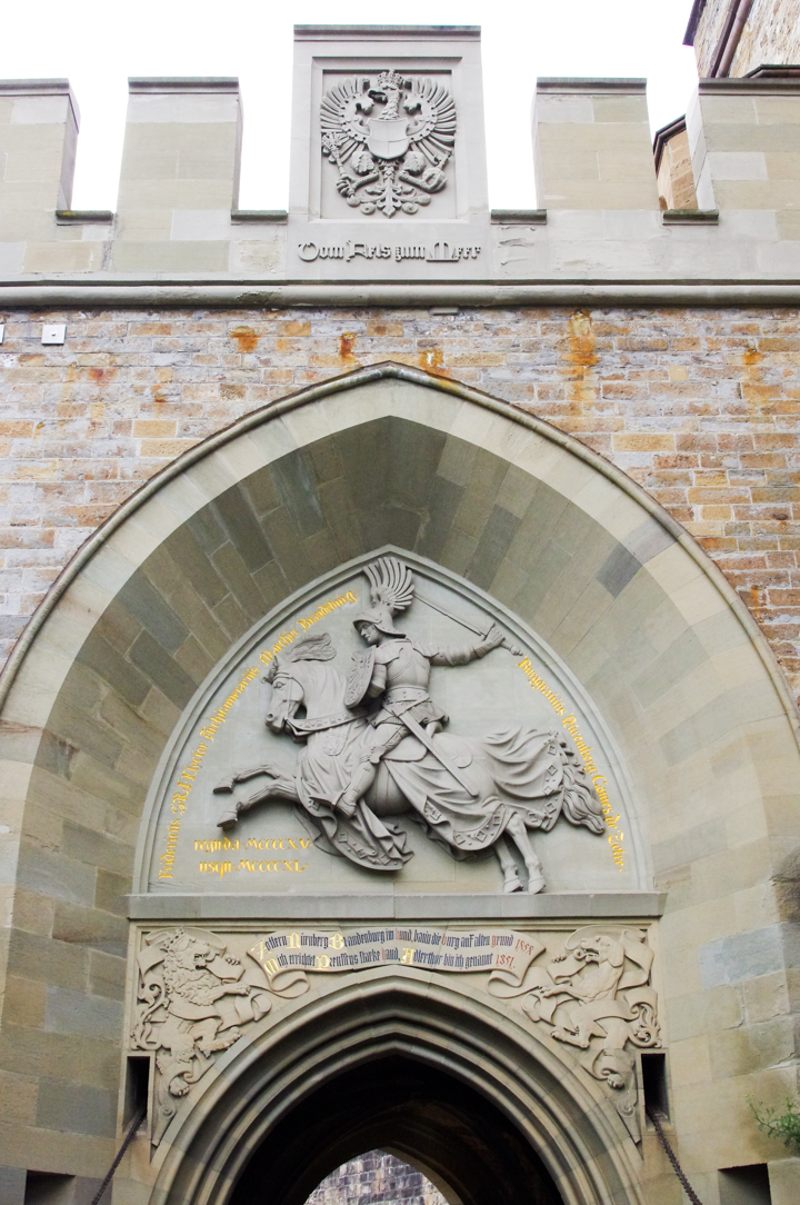 The Eagle Gateway of the Hohenzollern Castle in Germany - Check out roadtripsaroundtheworld.com to find out more