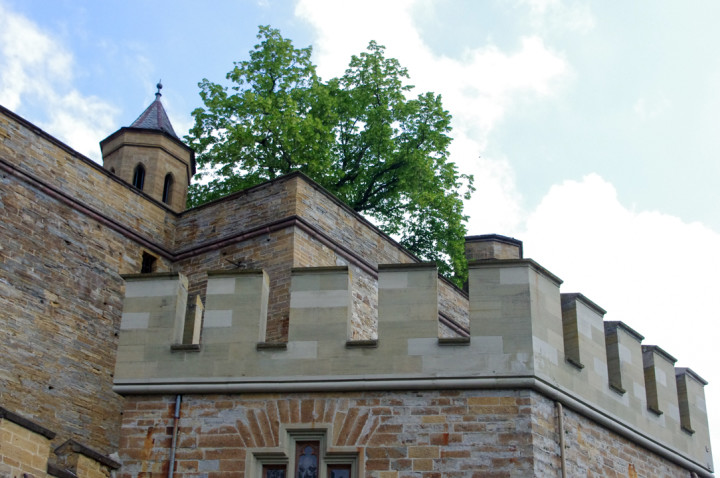 The fortification and crenels of the Hohenzollern Castle in Germany - Check out roadtripsaroundtheworld.com to find out more