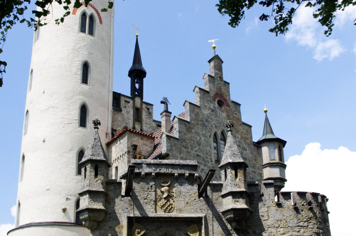 View of the incredible roofs of the Lichtenstein Castle - visited during a road trips in Germany - learn more on roadtripsaroundtheworld.com