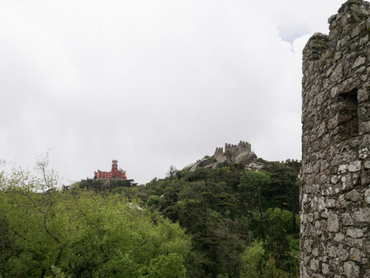 View of the Pena Palace and Royal tower of the Moors Castle, Sintra - Portugal - Learn more on roadtripsaroundtheworld.com
