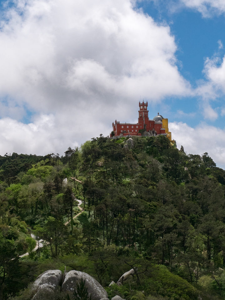 View of the Pena Palace from the Moors Castle, Sintra - Portugal - Learn more on roadtripsaroundtheworld.com