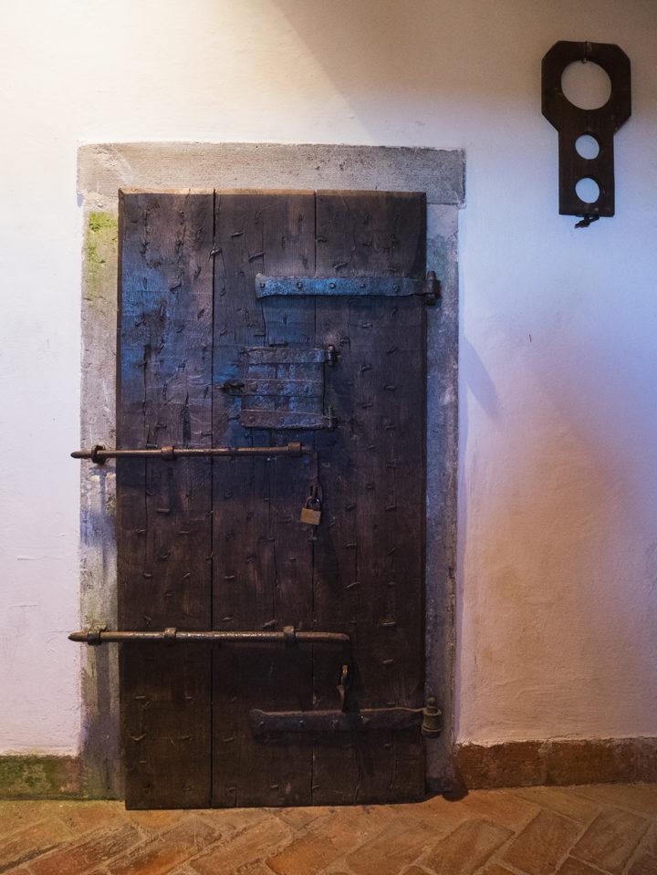 a-door-in-the-predjama-castle-slovenia-learn-more-on-www-roadtripsaroundtheworld-com