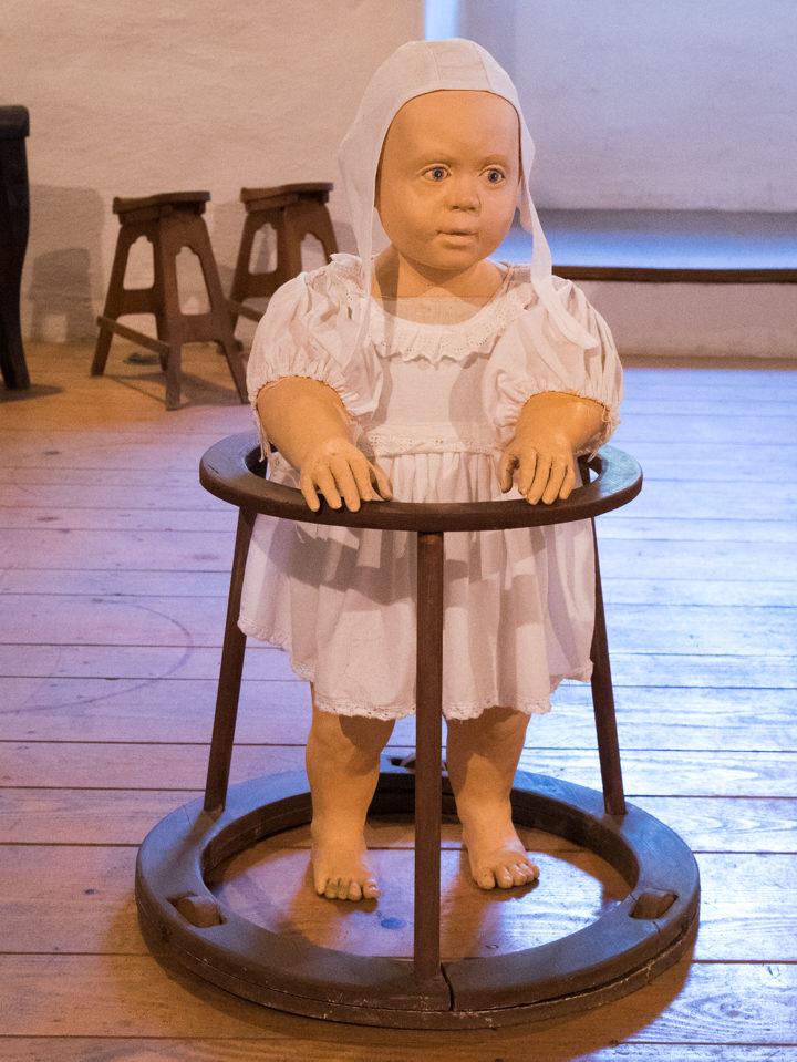 antique-baby-walker-predjama-castle-slovenia-learn-more-on-www-roadtripsaroundtheworld-com