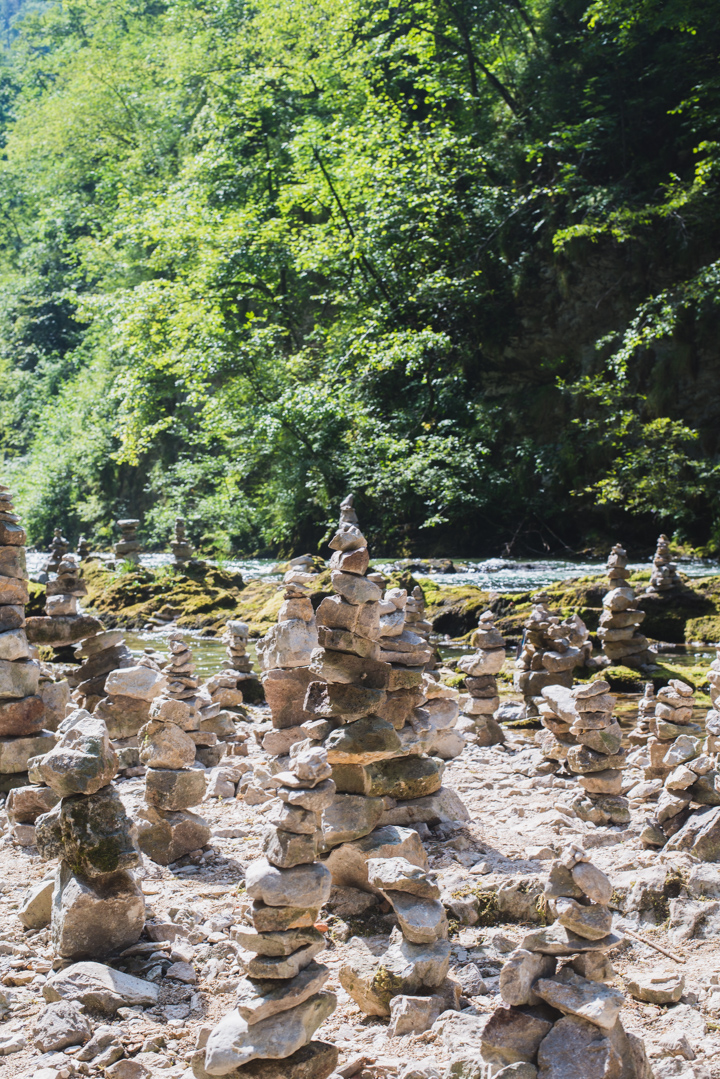 Cairns in the the Vintgar Gorge -Slovenia - Learn more on www.RoadTripsaroundtheWorld.com