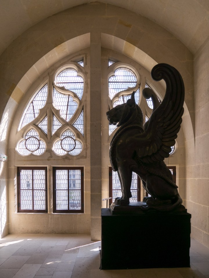 The landing of the guest wing staircase - Chateau de Pierrefonds, France - www.RoadTripsaroundtheWorld.com