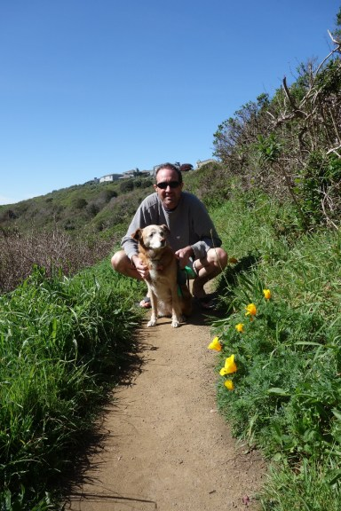 Lola and Mark on the trail to the beach