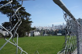 Alamo Square is currently closed for renovations, but a strategically created hole allows for photos