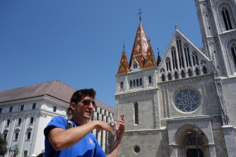 Guide Peter explaining a few things in front of Matthias Church