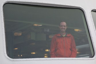 Mark prefers to remain indoors during the 1.5-hour ferry ride.