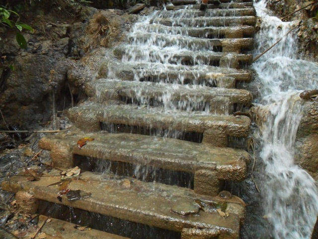 Wet steps to the very top of the waterfall in Luang Prabang, Laos.
