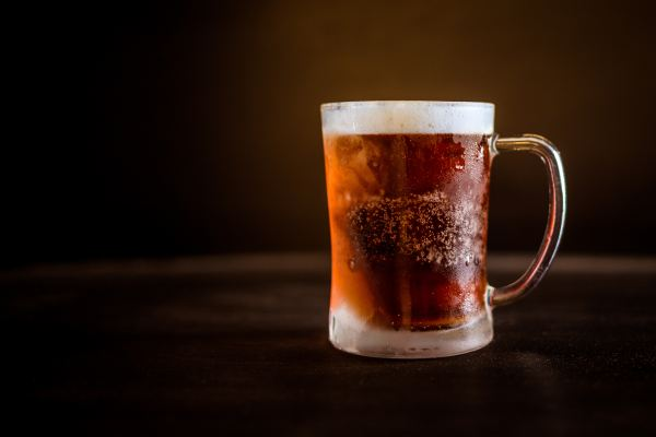 Dear Diary - Glass of brown beer. Rob Gregory Author