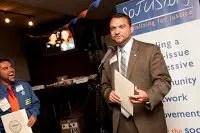 Robbie receiving award from Boston City Councelor Felix Arroyo