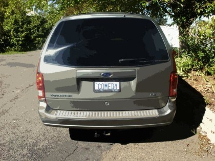 "Picture of Robb's minivan featuring his license plate with the word ""COMEDY."" This is really his plate!"