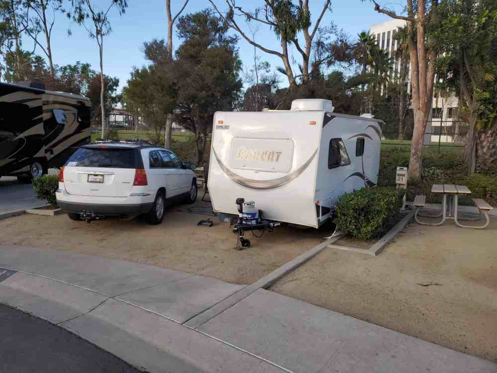 "Photo of our Long Beach campsite while being near family. Yes, the ""Comedy"" plates on my SUV are the real deal, not photoshopped."