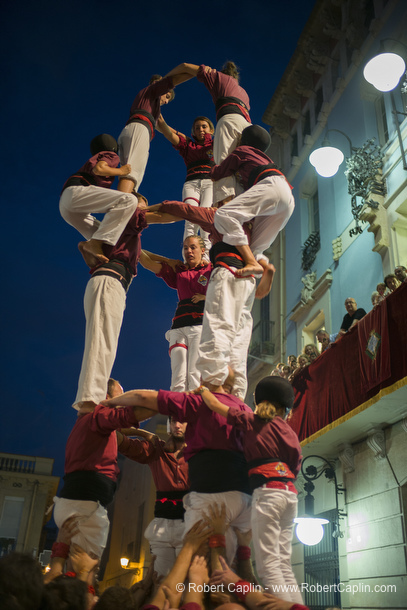 Castellers building human towers in Gracia, Barcelona.  Photo by Robert Caplin