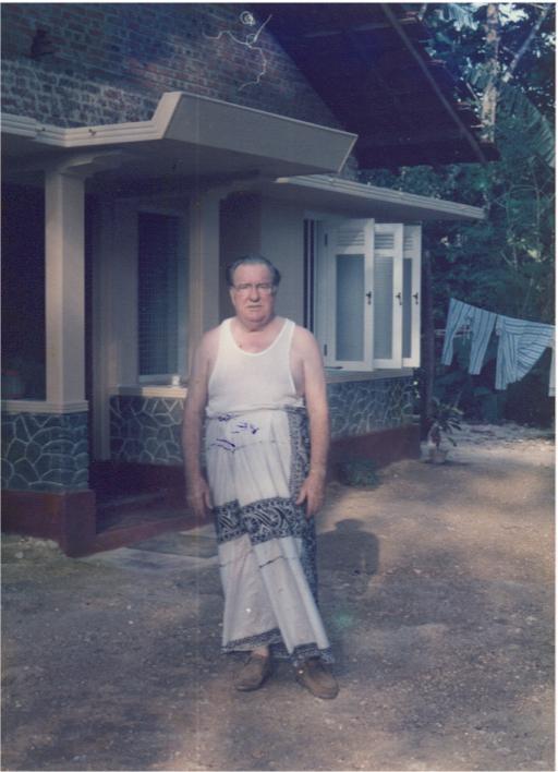 Robert E. Hill in sarong
