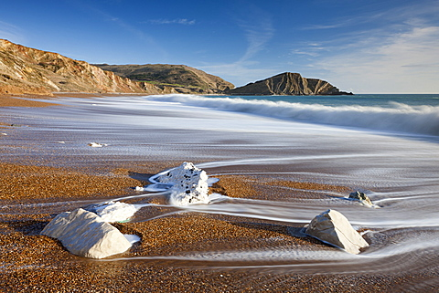 Waves wash clean the beautiful beach at Worbarrow Bay on the Jurassic Coast, UNESCO World Heritage Site, Dorset, England, United Kingdom, Europe