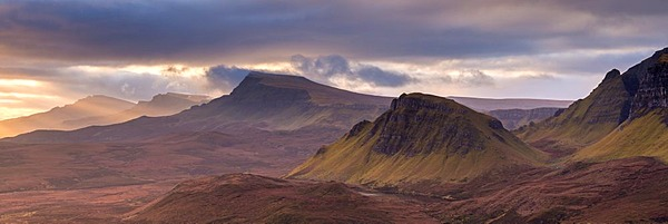 The Trotternish mountain range at dawn viewed from the Quiraing, Isle of Skye, Scotland. Winter (December) 2013.