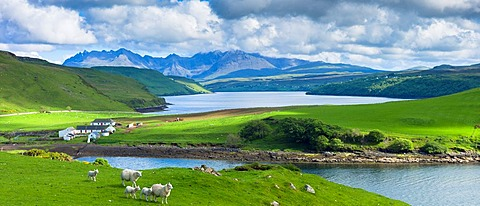 Traditional Scottish farm and loch with backdrop of The Cuillins mountains on the Isle of Skye in the Western Isles of Scotland