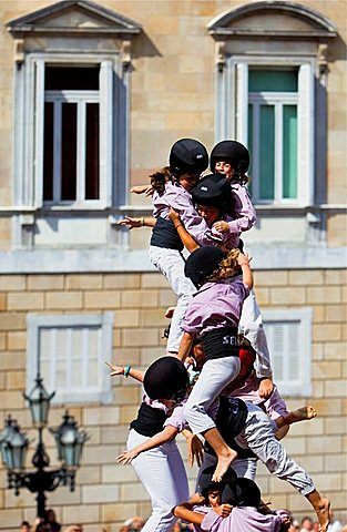Minyons de Terrassa Human tower falling, Castellers is a Catalan tradition Festa de la Merce, city festival Placa de Sant Jaume Barcelona, Spain