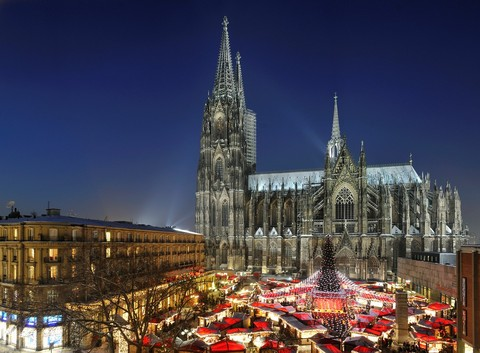 Christmans Market on Roncalli Place with Cathedral at Night, Cologne, Germany
