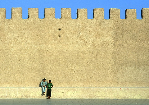 Young boys sitting on fort walls, Essaouira, Morocco