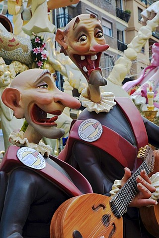 Gap-toothed musicians wearing uniforms, sculptures of the Faculty of Drinkers at a parade, Fallas festival, Falles festival in Valencia in early spring, Spain, Europe